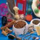 Bowl of pet food & supplies including dog food, cat food, bones, treats, brushes and pet toys
