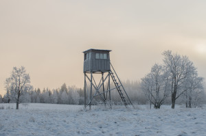 Hunting tower in harsh winter in the Lithuanian field